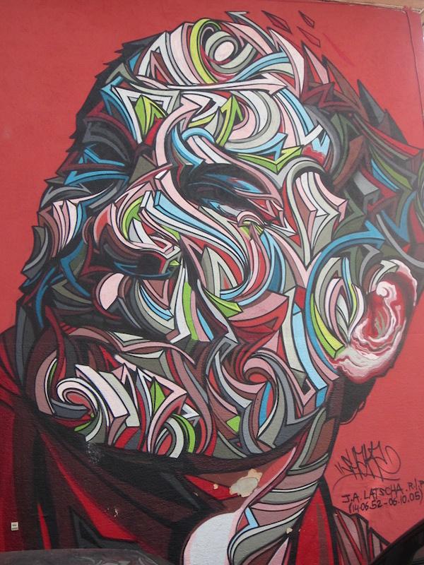 un portrait mural sur un bâtiment à mulhouse